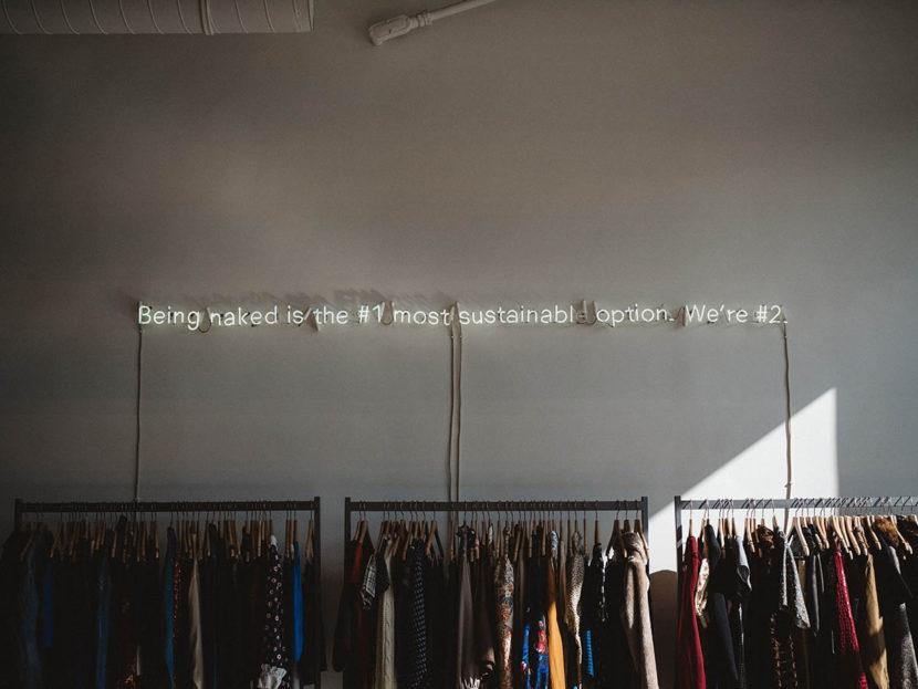 clothes racks on grey wall
